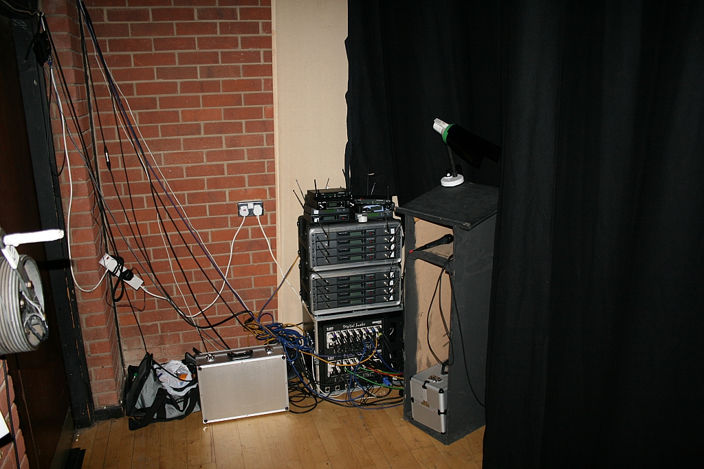 ASM desk amongst the radio mic recivers and digital stage box