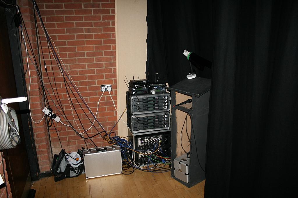 ASM desk amongst the radio mic recivers and digital stage box